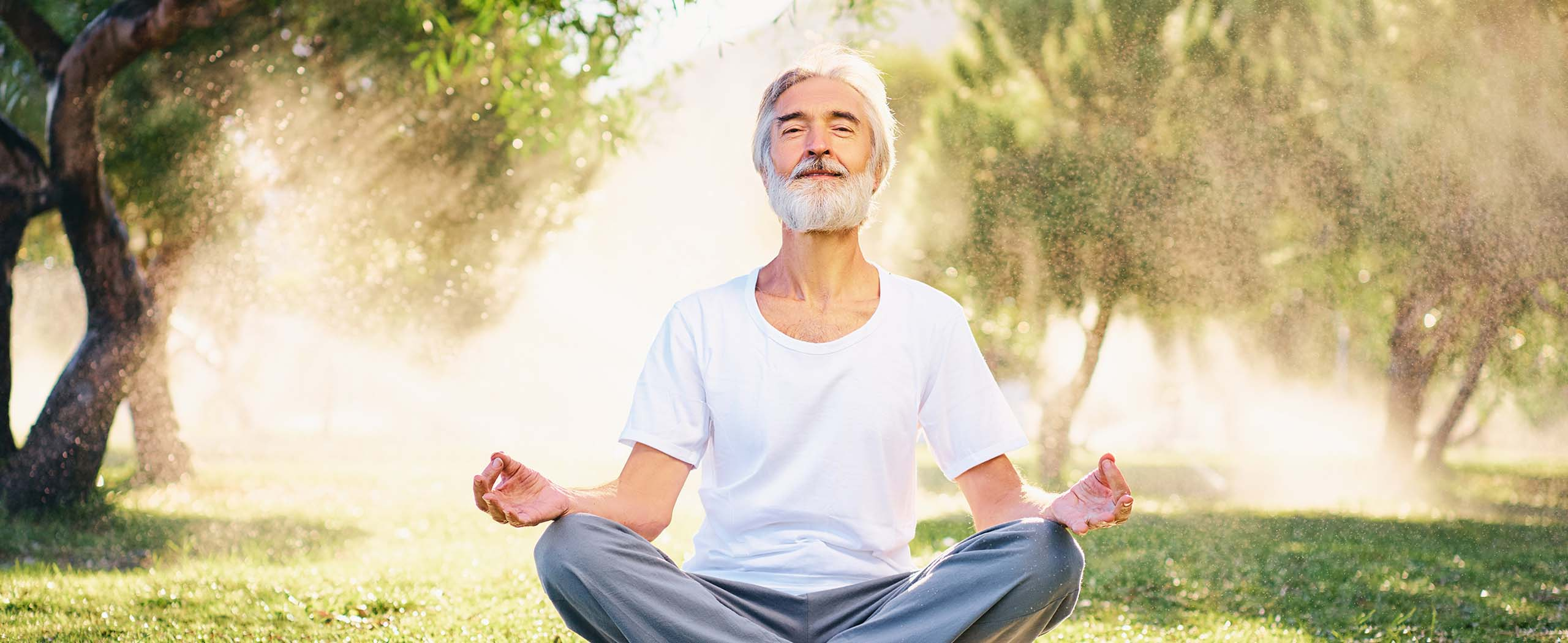 middle-aged man meditating outdoors