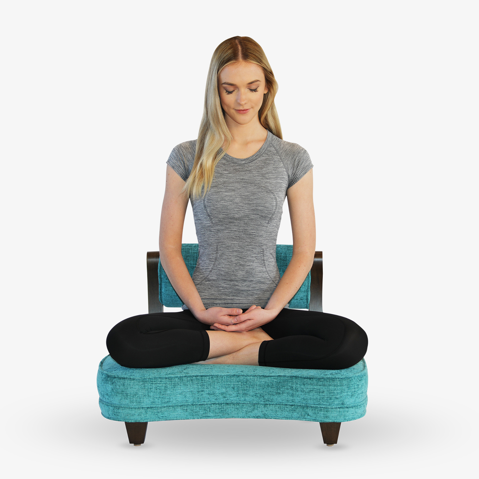 A woman meditating in The Rama Meditation Chair in the full lotus pose.