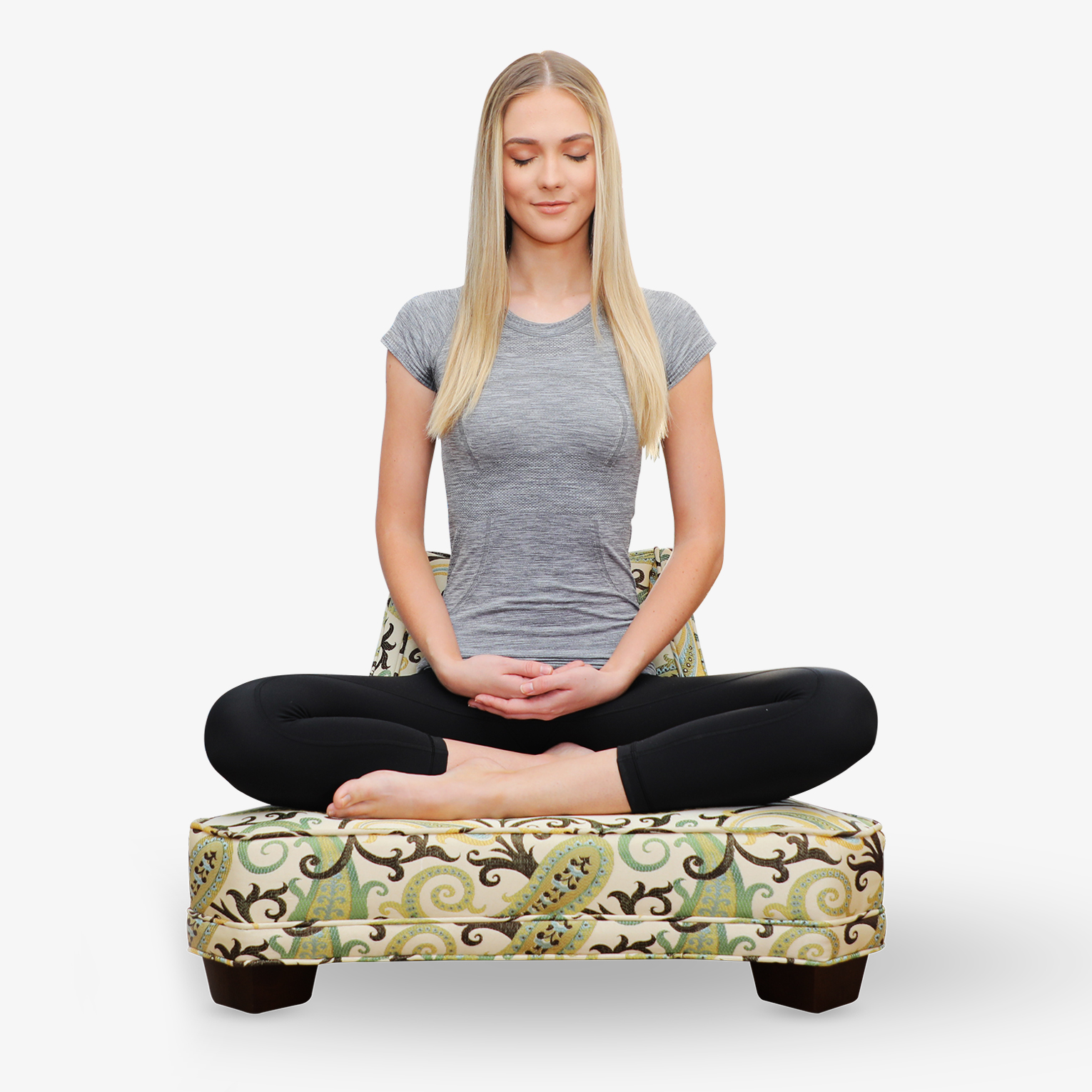 A woman meditating in the full lotus pose on The Samurai Meditation Chair.